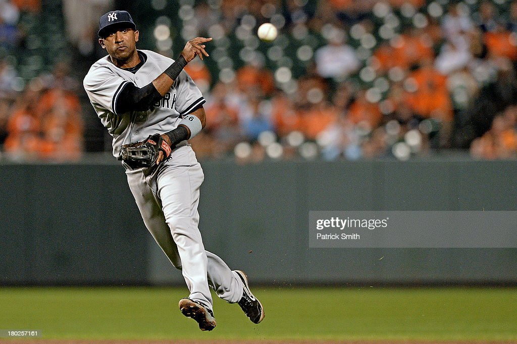Shortstop Eduardo Nunez #26 of the New York Yankees throws out Nick Markakis #21 of the Baltimore Orioles (not pictured) in the third inning at Oriole Park at Camden Yards on September 10, 2013 in Baltimore, Maryland.