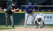Shortstop Elvis Andrus center celebrates a victory after tagging out Robinson Cano of the Seattle Mariners at second base while second base umpire...