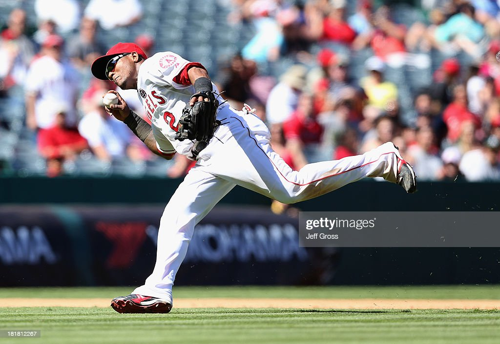 Shortstop <a gi-track='captionPersonalityLinkClicked' href=/galleries/search?phrase=Erick+Aybar&family=editorial&specificpeople=551376 ng-click='$event.stopPropagation()'>Erick Aybar</a> #2 of the Los Angeles Angels of Anaheim fakes a throw to first on a hit by Yoenis Cespedes of the Oakland Athletics in the sixth inning at Angel Stadium of Anaheim on September 25, 2013 in Anaheim, California. The Angels defeated the Athletics 3-1.