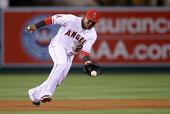 Shortstop Erick Aybar of the Los Angeles Angels of Anaheim fields a ground ball by Erick Aybar of the Texas Rangers in the first inning at Angel...