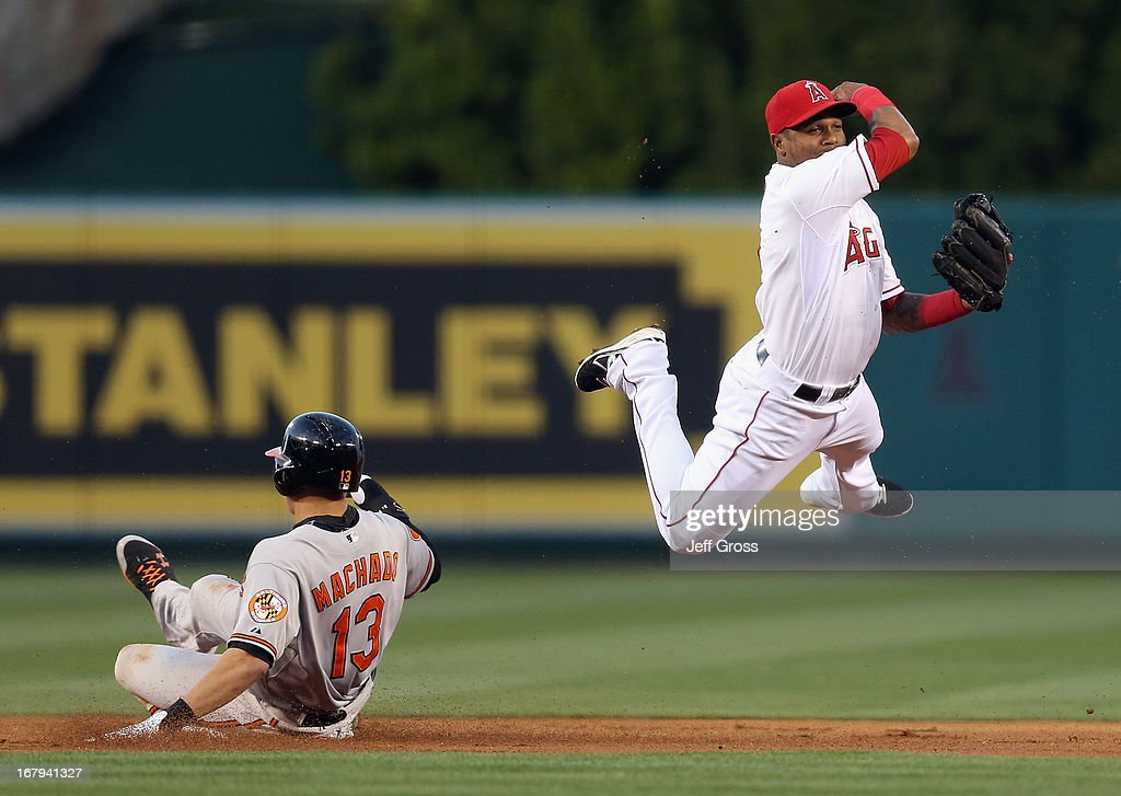 Shortstop <a gi-track='captionPersonalityLinkClicked' href=/galleries/search?phrase=Erick+Aybar&family=editorial&specificpeople=551376 ng-click='$event.stopPropagation()'>Erick Aybar</a> #2 of the Los Angeles Angels of Anaheim forces <a gi-track='captionPersonalityLinkClicked' href=/galleries/search?phrase=Manny+Machado&family=editorial&specificpeople=5591039 ng-click='$event.stopPropagation()'>Manny Machado</a> #13 of the Baltimore Orioles out at second base before throwing to first to complete the double play in the first inning at Angel Stadium of Anaheim on May 2, 2013 in Anaheim, California.