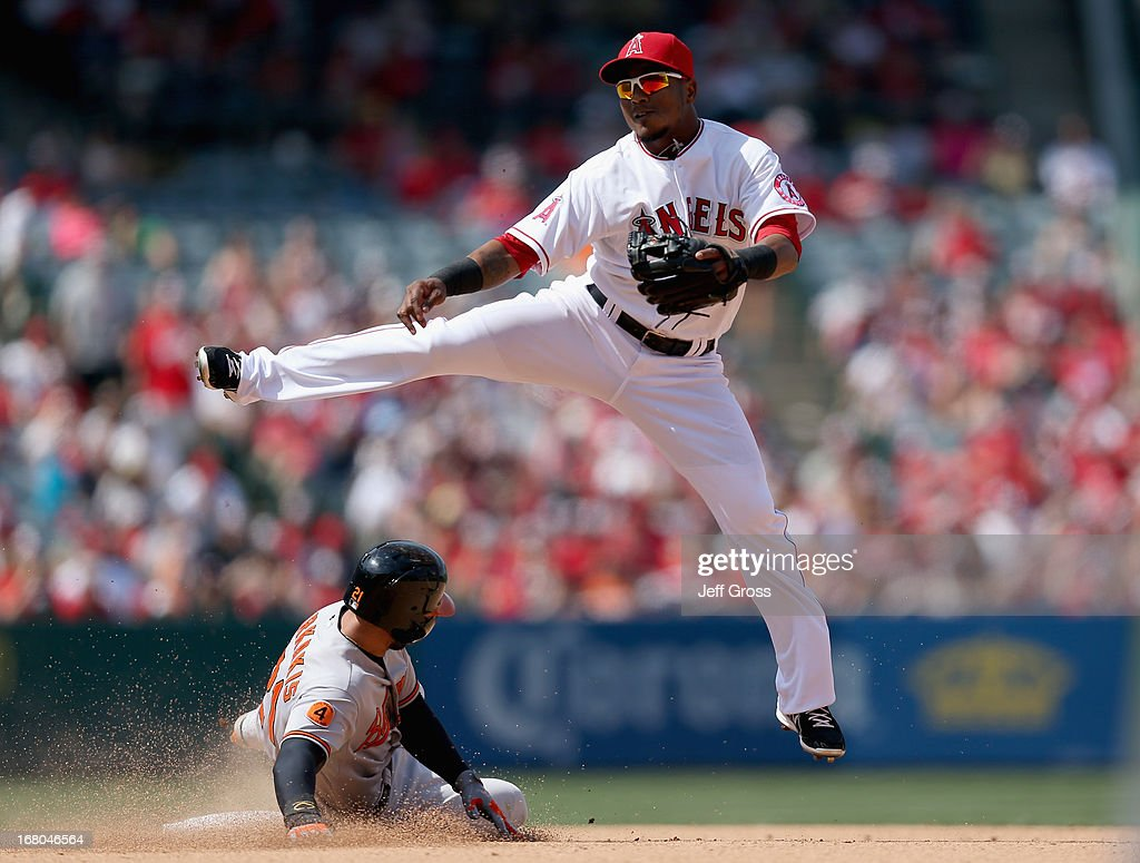 Shortstop <a gi-track='captionPersonalityLinkClicked' href=/galleries/search?phrase=Erick+Aybar&family=editorial&specificpeople=551376 ng-click='$event.stopPropagation()'>Erick Aybar</a> #2 of the Los Angeles Angels of Anaheim forces <a gi-track='captionPersonalityLinkClicked' href=/galleries/search?phrase=Nick+Markakis&family=editorial&specificpeople=614708 ng-click='$event.stopPropagation()'>Nick Markakis</a> #21 of the Baltimore Orioles out at second base before throwing to first to complete the double play in the seventh inning at Angel Stadium of Anaheim on May 4, 2013 in Anaheim, California. The Orioles defeated the Angels 5-4 in ten innings.