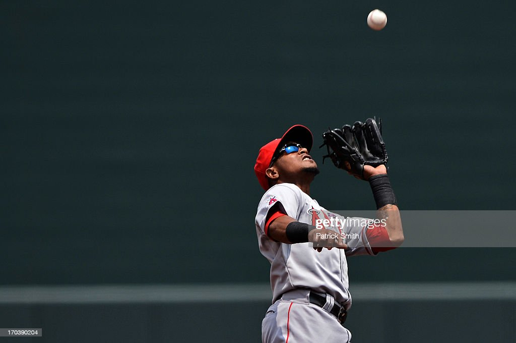 Shortstop <a gi-track='captionPersonalityLinkClicked' href=/galleries/search?phrase=Erick+Aybar&family=editorial&specificpeople=551376 ng-click='$event.stopPropagation()'>Erick Aybar</a> #2 of the Los Angeles Angels of Anaheim makes a catch in the first inning against the Baltimore Orioles at Oriole Park at Camden Yards on June 12, 2013 in Baltimore, Maryland. The Los Angeles Angels of Anaheim won, 9-5.