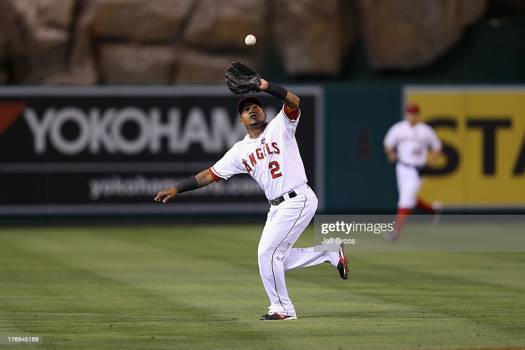 Shortstop <a gi-track='captionPersonalityLinkClicked' href=/galleries/search?phrase=Erick+Aybar&family=editorial&specificpeople=551376 ng-click='$event.stopPropagation()'>Erick Aybar</a> #2 of the Los Angeles Angels of Anaheim makes a catch on pop fly by Michael Brantley (not pictured) of the Cleveland Indians in the fourth inning at Angel Stadium of Anaheim on August 19, 2013 in Anaheim, California.
