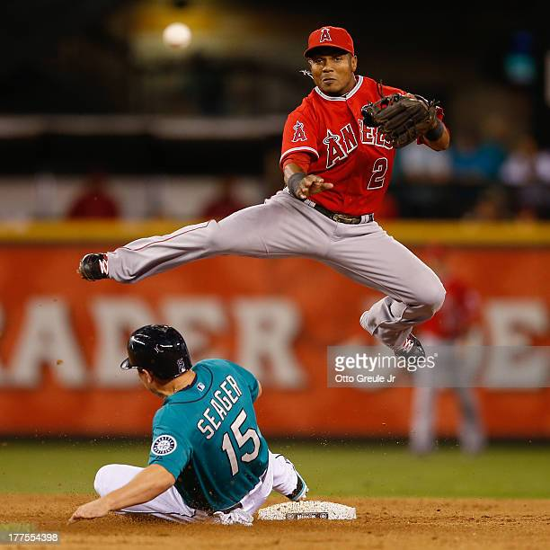 Shortstop Erick Aybar of the Los Angeles Angels of Anaheim turns a double play over Kyle Seager of the Seattle Mariners in the sixth inning at Safeco...
