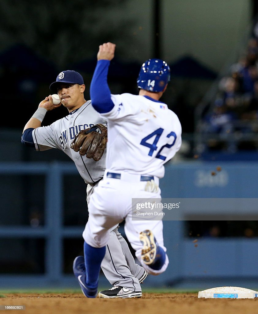 Shortstop <a gi-track='captionPersonalityLinkClicked' href=/galleries/search?phrase=Everth+Cabrera&family=editorial&specificpeople=5743470 ng-click='$event.stopPropagation()'>Everth Cabrera</a> of the San Diego Padres throws to first after forcing out Mark Ellis of the Los Angeles Dodgers to complete a double play ending the seventh inning at Dodger Stadium on April 15, 2013 in Los Angeles, California. All uniformed team members are wearing jersey number 42 in honor of Jackie Robinson Day.