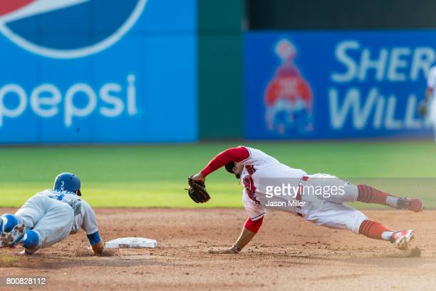 Shortstop Francisco Lindor of the Cleveland Indians attempts to tag out Chris Taylor of the Los Angeles Dodgers at first during the second inning at...
