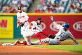 Shortstop Francisco Lindor of the Cleveland Indians tags out Reymond Fuentes of the Kansas City Royals on a steal attempt to end the second inning at...