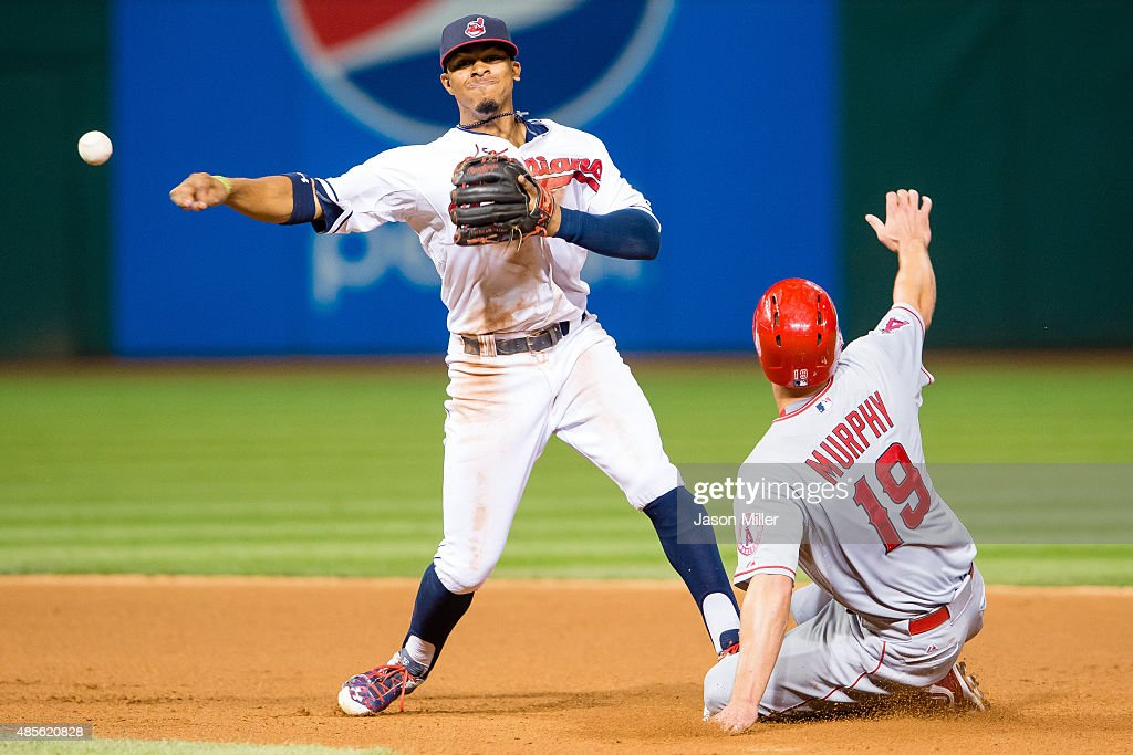 Shortstop <a gi-track='captionPersonalityLinkClicked' href=/galleries/search?phrase=Francisco+Lindor&family=editorial&specificpeople=8126906 ng-click='$event.stopPropagation()'>Francisco Lindor</a> #12 of the Cleveland Indians throws out C.J. Cron #24 at first as <a gi-track='captionPersonalityLinkClicked' href=/galleries/search?phrase=David+Murphy+-+Baseball+Player&family=editorial&specificpeople=4604222 ng-click='$event.stopPropagation()'>David Murphy</a> #19 of the Los Angeles Angels of Anaheim is out at second for a double play during the seventh inning at Progressive Field on August 26, 2015 in Cleveland, Ohio.