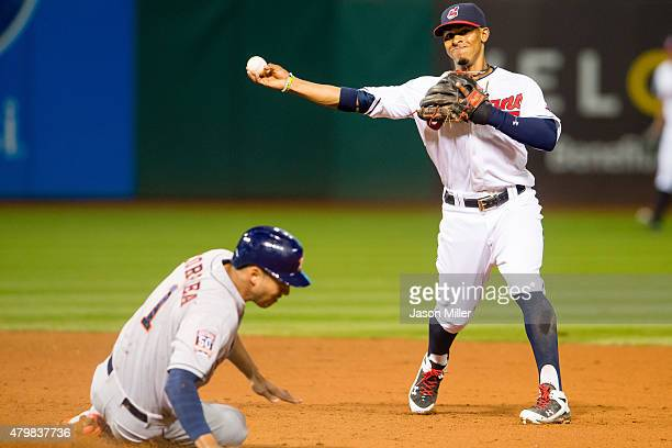 Shortstop Francisco Lindor of the Cleveland Indians throws out Evan Gattis of the Houston Astros at first as Carlos Correa is out at second for the...