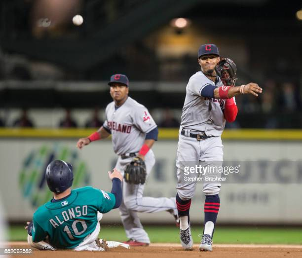 Shortstop Francisco Lindor of the Cleveland Indians turns a double play after forcing out Yonder Alonso of the Seattle Mariners at second base on a...