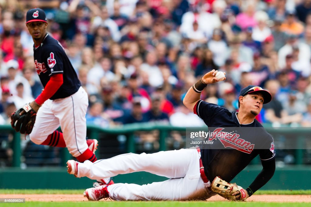 Shortstop Francisco Lindor #12 watches as third baseman Giovanny Urshela #39 of the Cleveland Indians throws out Jeimer Candelario #46 of the Detroit Tigers at second during the eighth inning at Progressive Field on September 13, 2017 in Cleveland, Ohio. The Indians defeated the Tigers to win 21 straight games.