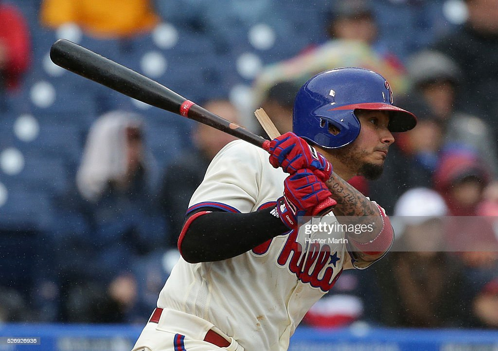 Shortstop Freddy Galvis #13 of the Philadelphia Phillies breaks his bat on an RBI single in the third inning during a game against the Cleveland Indians at Citizens Bank Park on May 1, 2016 in Philadelphia, Pennsylvania.