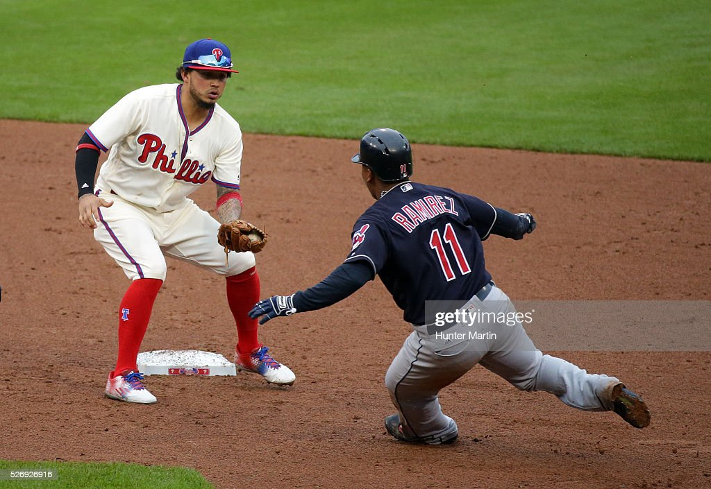 Shortstop Freddy Galvis #13 of the Philadelphia Phillies tags out Jose Ramirez #11 of the Cleveland Indians on a stolen base attempt in the third inning during a game at Citizens Bank Park on May 1, 2016 in Philadelphia, Pennsylvania.
