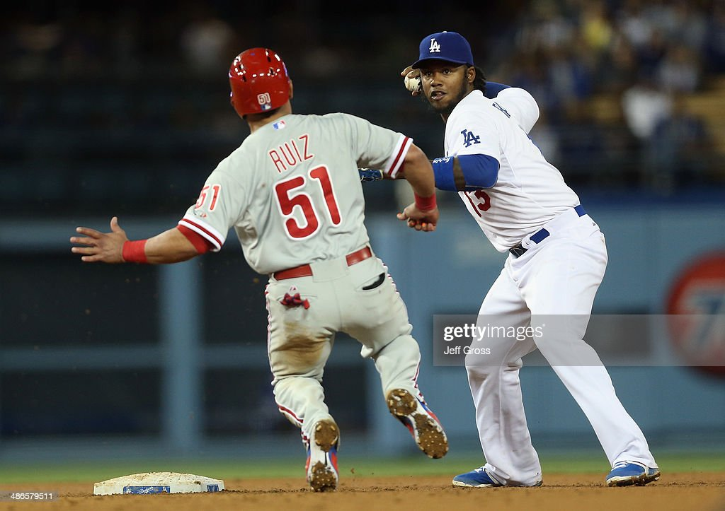 Shortstop <a gi-track='captionPersonalityLinkClicked' href=/galleries/search?phrase=Hanley+Ramirez&family=editorial&specificpeople=538406 ng-click='$event.stopPropagation()'>Hanley Ramirez</a> #13 of the Los Angeles Dodgers forces Carlos Ruiz #51 of the Philadelphia Phillies out at second before throwing to first to complete the double play in the seventh inning at Dodger Stadium on April 24, 2014 in Los Angeles, California.