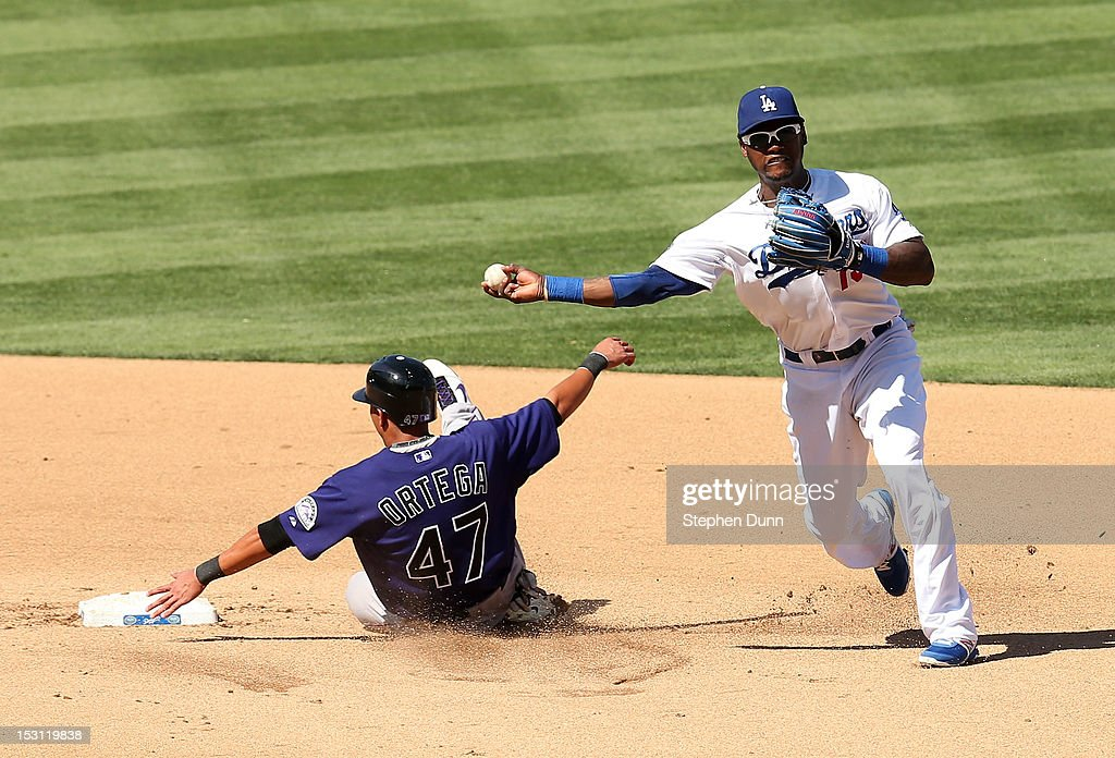Shortstop Hanley Ramirez #13 of the Los Angeles Dodgers throws to first after forcing out Rafael Ortega #47 of the Colorado Rockies to complete a double play ending the third inning with the bases loaded on September 30, 2012 at Dodger Stadium in Los Angeles, California.