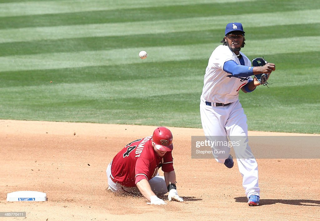 Shortstop <a gi-track='captionPersonalityLinkClicked' href=/galleries/search?phrase=Hanley+Ramirez&family=editorial&specificpeople=538406 ng-click='$event.stopPropagation()'>Hanley Ramirez</a> #13 of the Los Angeles Dodgers throws to first to complete a double play after forcing out <a gi-track='captionPersonalityLinkClicked' href=/galleries/search?phrase=Paul+Goldschmidt&family=editorial&specificpeople=7511120 ng-click='$event.stopPropagation()'>Paul Goldschmidt</a> #44 of the Arizona Diamondbacks at Dodger Stadium on April 20, 2014 in Los Angeles, California. The Dodgers won 4-1.