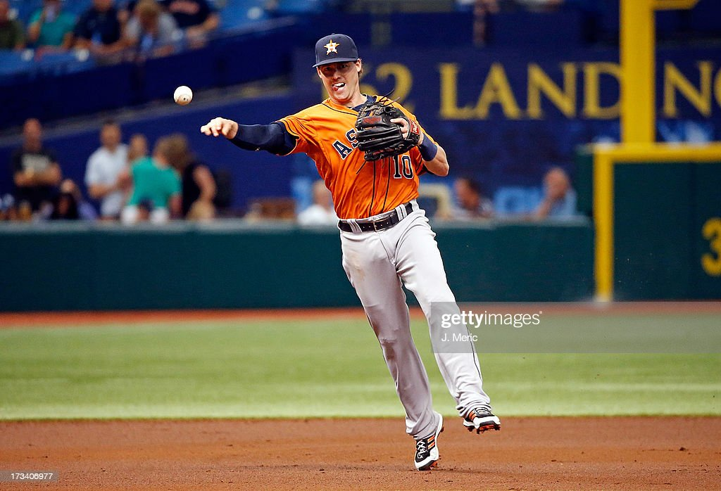 Shortstop Jake Elmore #10 of the Houston Astros throws over to first for an out against the Tampa Bay Rays during the game at Tropicana Field on July 13, 2013 in St. Petersburg, Florida.