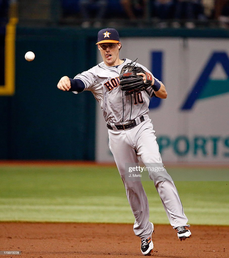 Shortstop Jake Elmore #10 of the Houston Astros throws to first base for an out in the first inning against the Tampa Bay Rays at Tropicana Field on July 12, 2013 in St. Petersburg, Florida.