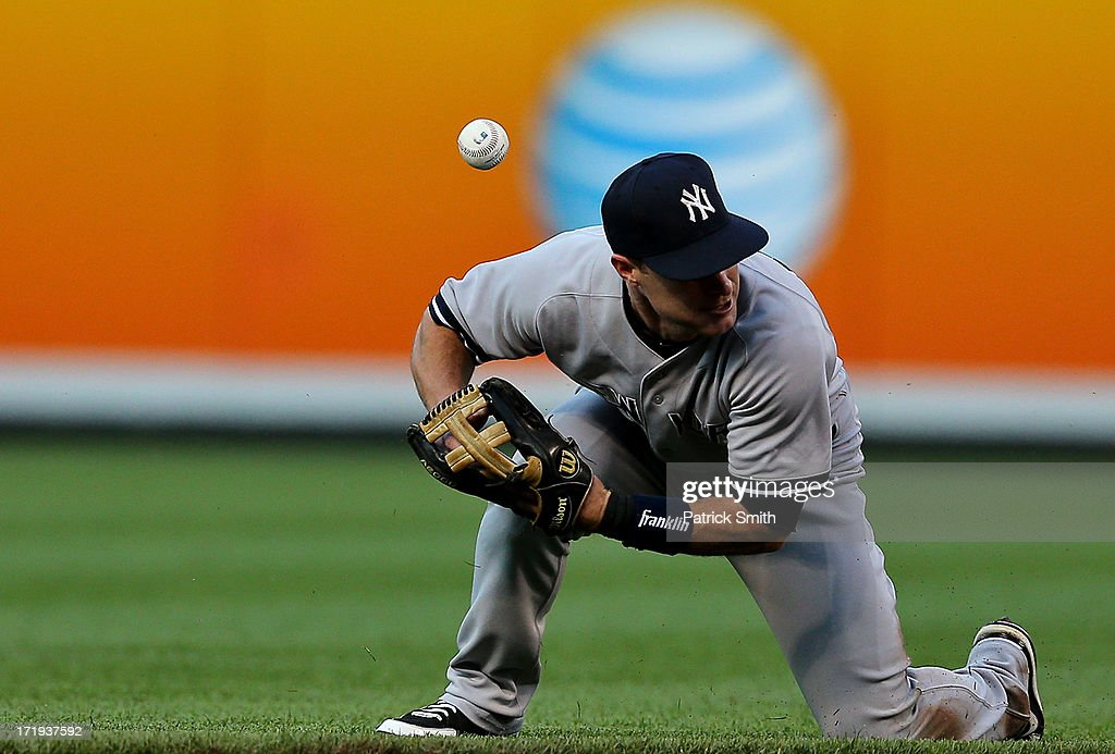 Shortstop <a gi-track='captionPersonalityLinkClicked' href=/galleries/search?phrase=Jayson+Nix&family=editorial&specificpeople=836132 ng-click='$event.stopPropagation()'>Jayson Nix</a> #17 of the New York Yankees cannot handle a hit by Manny Machado #13 of the Baltimore Orioles (not pictured) in the first inning at Oriole Park at Camden Yards on June 29, 2013 in Baltimore, Maryland.