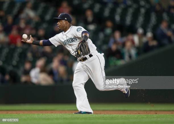 Shortstop Jean Segura bobbles a ball hit by Trevor Story of the Colorado Rockies during the eighth inning of a game at Safeco Field on May 31 2017 in...