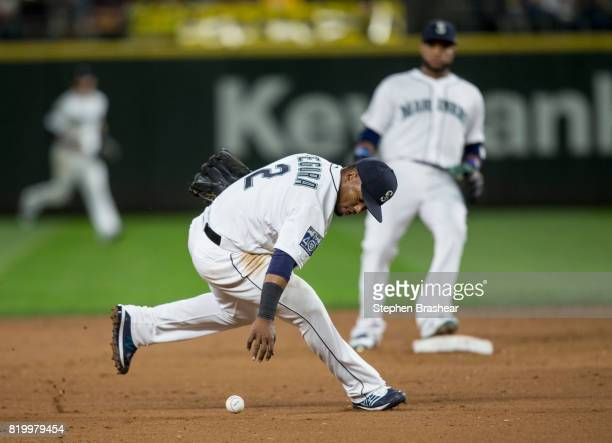 Shortstop Jean Segura of the Seattle Mariners commits an error trying to field a ball off the bat of Brett Gardner of the New York Yankees against...
