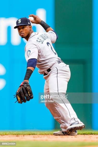 Shortstop Jean Segura of the Seattle Mariners throws out Jose Ramirez of the Cleveland Indians at first to end the eighth inning at Progressive Field...