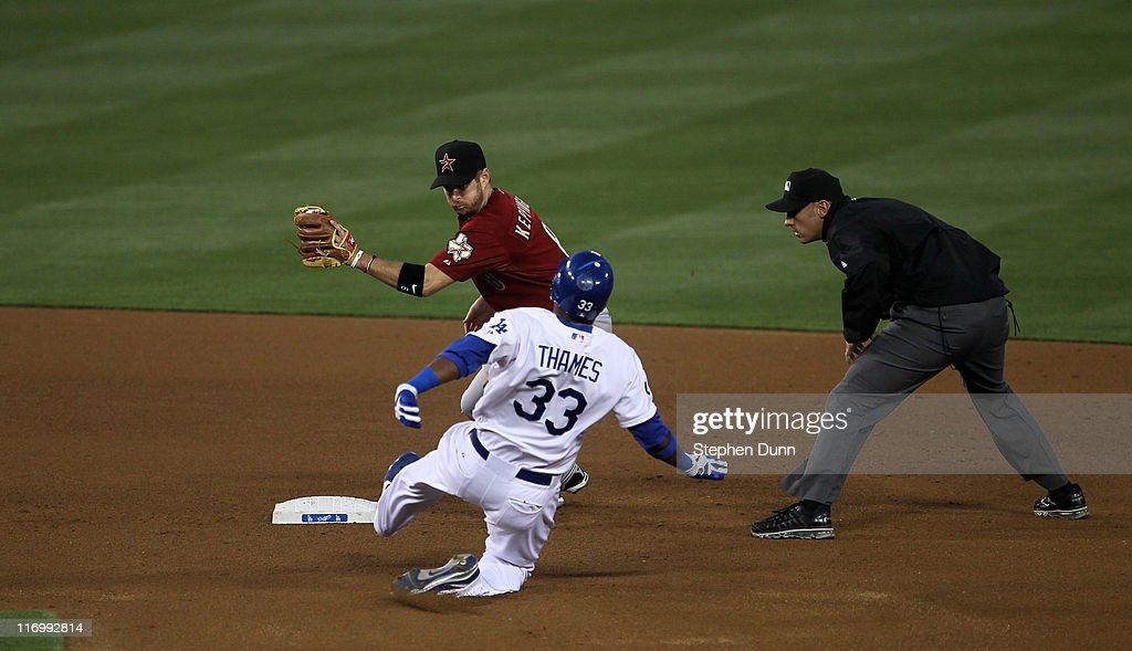 Shortstop Jeff Keppinger #8 of the Houston Astros tags out <a gi-track='captionPersonalityLinkClicked' href=/galleries/search?phrase=Marcus+Thames&family=editorial&specificpeople=215472 ng-click='$event.stopPropagation()'>Marcus Thames</a> #33 of the Los Angeles Dodgers trying to stretch out a double in the fourth inning on June 18, 2011 at Dodger Stadium in Los Angeles, California.