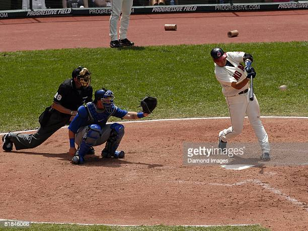 Shortstop Jhonny Peralta of the Cleveland Indians bats with catcher Jarrod Saltalamacchia of the Texas Rangers and homeplate umpire Bill Hohn looking...