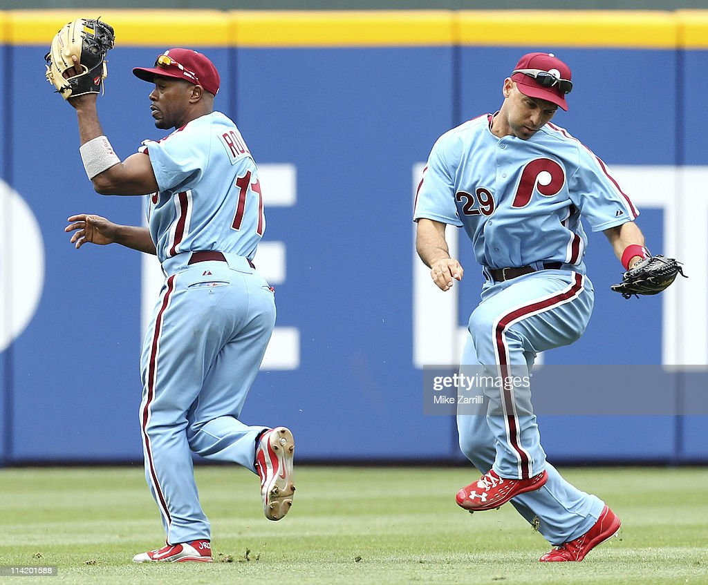 Shortstop Jimmy Rollins #11 and left fielder Raul Ibanez #29 of the Philadelphia Phillies narrowly avoid a collision in the outfield on a pop-up during the MLB Civil Rights Game against the Atlanta Braves on Sunday, May 15, 2011 at Turner Field in Atlanta, Georgia.