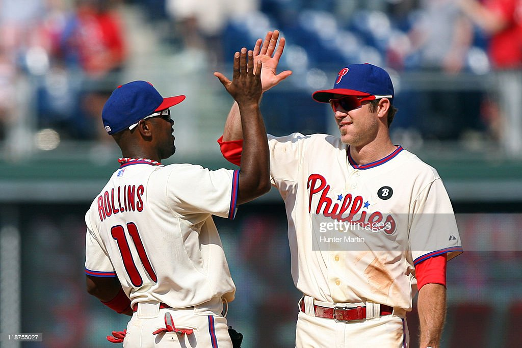 Shortstop <a gi-track='captionPersonalityLinkClicked' href=/galleries/search?phrase=Jimmy+Rollins&family=editorial&specificpeople=204478 ng-click='$event.stopPropagation()'>Jimmy Rollins</a> #11 and second baseman <a gi-track='captionPersonalityLinkClicked' href=/galleries/search?phrase=Chase+Utley&family=editorial&specificpeople=161391 ng-click='$event.stopPropagation()'>Chase Utley</a> #26 of the Philadelphia Phillies high-five after winning a game against the Atlanta Braves at Citizens Bank Park on July 10, 2011 in Philadelphia, Pennsylvania. The Phillies won 14-1.