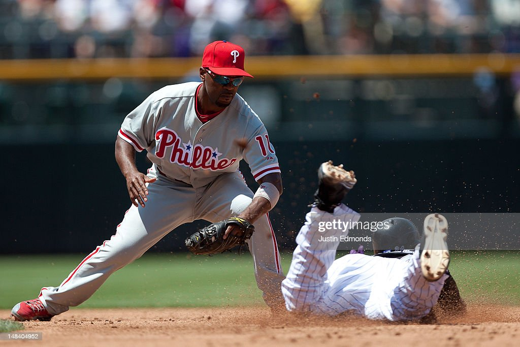 Shortstop <a gi-track='captionPersonalityLinkClicked' href=/galleries/search?phrase=Jimmy+Rollins&family=editorial&specificpeople=204478 ng-click='$event.stopPropagation()'>Jimmy Rollins</a> #11 of the Philadelphia Phillies apples the tag to <a gi-track='captionPersonalityLinkClicked' href=/galleries/search?phrase=Dexter+Fowler&family=editorial&specificpeople=4949024 ng-click='$event.stopPropagation()'>Dexter Fowler</a> #24 of the Colorado Rockies on a caught stealing attempt at Coors Field on July 15, 2012 in Denver, Colorado. The Phillies defeated the Rockies 5-1.