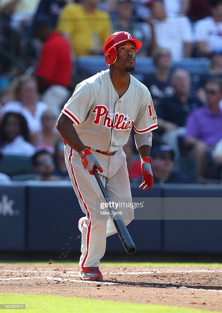 Shortstop <a gi-track='captionPersonalityLinkClicked' href=/galleries/search?phrase=Jimmy+Rollins&family=editorial&specificpeople=204478 ng-click='$event.stopPropagation()'>Jimmy Rollins</a> #11 of the Philadelphia Phillies breaks out of the batter's box during the game against the Atlanta Braves at Turner Field on September 1, 2012 in Atlanta, Georgia.