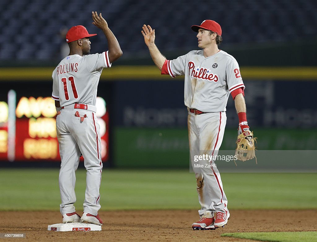 Shortstop <a gi-track='captionPersonalityLinkClicked' href=/galleries/search?phrase=Jimmy+Rollins&family=editorial&specificpeople=204478 ng-click='$event.stopPropagation()'>Jimmy Rollins</a> #11 of the Philadelphia Phillies celebrates with second baseman <a gi-track='captionPersonalityLinkClicked' href=/galleries/search?phrase=Chase+Utley&family=editorial&specificpeople=161391 ng-click='$event.stopPropagation()'>Chase Utley</a> #26 after the game against the Atlanta Braves at Turner Field on June 16, 2014 in Atlanta, Georgia.