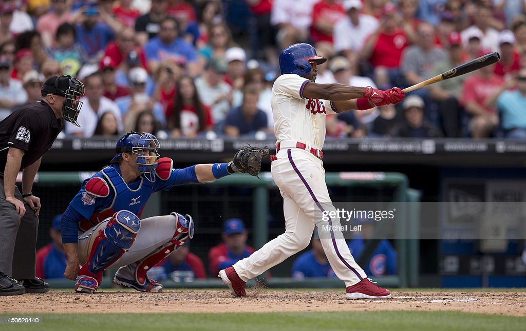 Shortstop Jimmy Rollins #11 of the Philadelphia Phillies hits a single in the bottom of the fifth inning against the Chicago Cubs on June 14, 2014 at Citizens Bank Park in Philadelphia, Pennsylvania. This single makes Jimmy Rollins the all-time Phillies career hit leader with 2,235 hits.