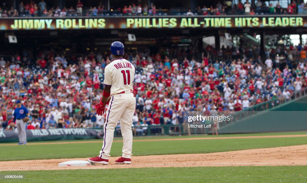 Shortstop <a gi-track='captionPersonalityLinkClicked' href=/galleries/search?phrase=Jimmy+Rollins&family=editorial&specificpeople=204478 ng-click='$event.stopPropagation()'>Jimmy Rollins</a> #11 of the Philadelphia Phillies hits a single in the bottom of the fifth inning against the Chicago Cubs on June 14, 2014 at Citizens Bank Park in Philadelphia, Pennsylvania. This single makes <a gi-track='captionPersonalityLinkClicked' href=/galleries/search?phrase=Jimmy+Rollins&family=editorial&specificpeople=204478 ng-click='$event.stopPropagation()'>Jimmy Rollins</a> the all-time Phillies career hit leader with 2,235 hits.