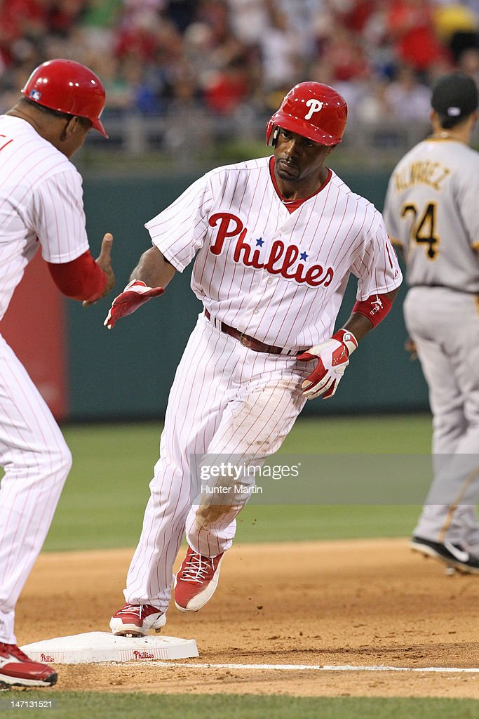 Shortstop <a gi-track='captionPersonalityLinkClicked' href=/galleries/search?phrase=Jimmy+Rollins&family=editorial&specificpeople=204478 ng-click='$event.stopPropagation()'>Jimmy Rollins</a> #11 of the Philadelphia Phillies rounds third base after hitting a home run during a game against the Pittsburgh Pirates at Citizens Bank Park on June 25, 2012 in Philadelphia, Pennsylvania.