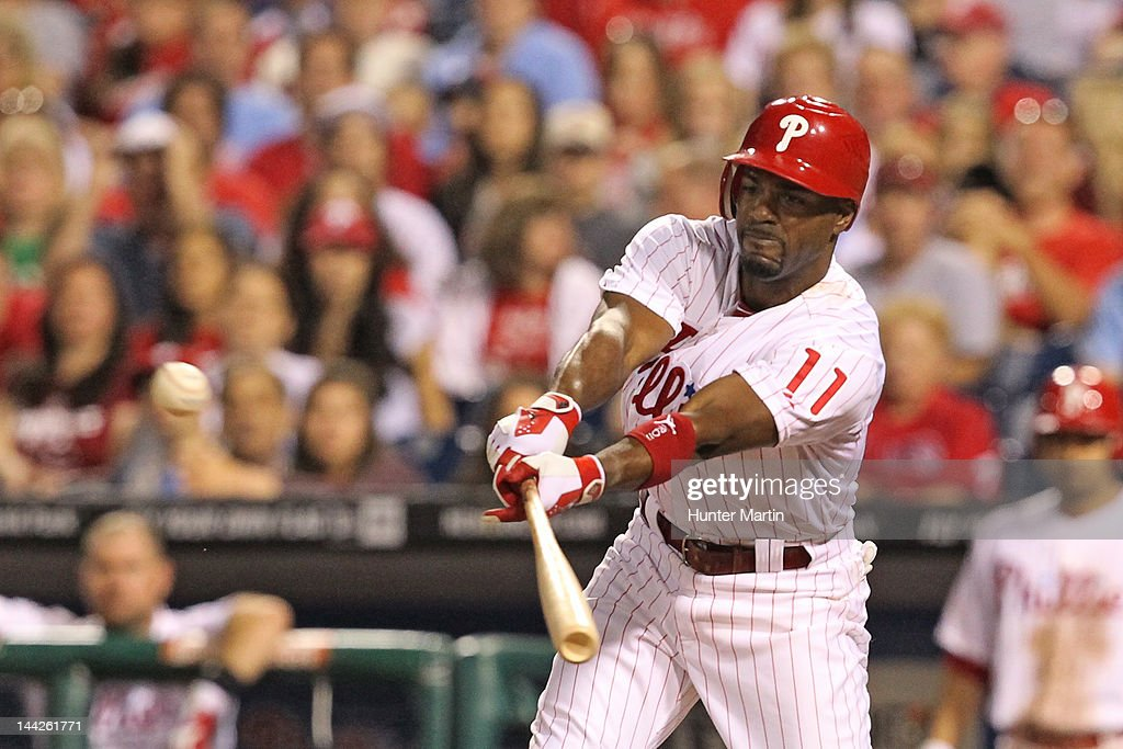 Shortstop <a gi-track='captionPersonalityLinkClicked' href=/galleries/search?phrase=Jimmy+Rollins&family=editorial&specificpeople=204478 ng-click='$event.stopPropagation()'>Jimmy Rollins</a> #11 of the Philadelphia Phillies singles to right field during a game against the San Diego Padres at Citizens Bank Park on May 12, 2012 in Philadelphia, Pennsylvania. The Padres won 2-1.