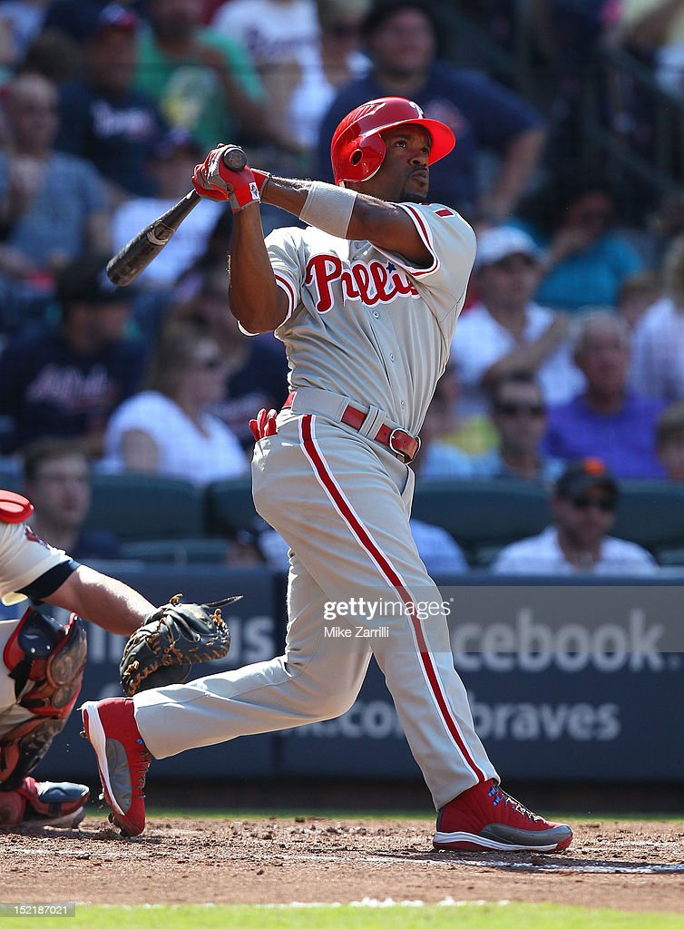 Shortstop <a gi-track='captionPersonalityLinkClicked' href=/galleries/search?phrase=Jimmy+Rollins&family=editorial&specificpeople=204478 ng-click='$event.stopPropagation()'>Jimmy Rollins</a> #11 of the Philadelphia Phillies swings during the game against the Atlanta Braves at Turner Field on September 1, 2012 in Atlanta, Georgia.