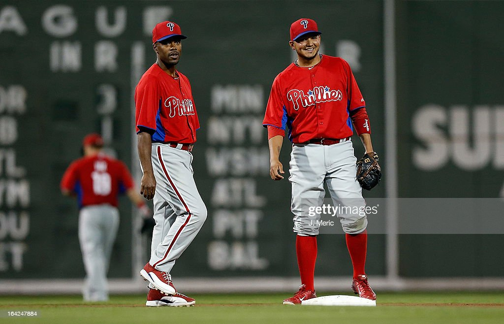 Shortstop <a gi-track='captionPersonalityLinkClicked' href=/galleries/search?phrase=Jimmy+Rollins&family=editorial&specificpeople=204478 ng-click='$event.stopPropagation()'>Jimmy Rollins</a> #11 (left) of the Philadelphia Phillies talks with second baseman Freddy Galvis #13 during a Grapefruit League Spring Training Game against the Boston Red Sox at JetBlue Park on March 21, 2013 in Fort Myers, Florida.