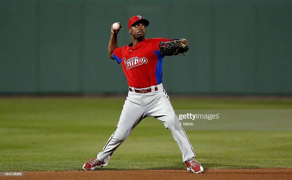 Shortstop <a gi-track='captionPersonalityLinkClicked' href=/galleries/search?phrase=Jimmy+Rollins&family=editorial&specificpeople=204478 ng-click='$event.stopPropagation()'>Jimmy Rollins</a> #11 of the Philadelphia Phillies throws over to first for an out against the Boston Red Sox during a Grapefruit League Spring Training Game at JetBlue Park on March 21, 2013 in Fort Myers, Florida.