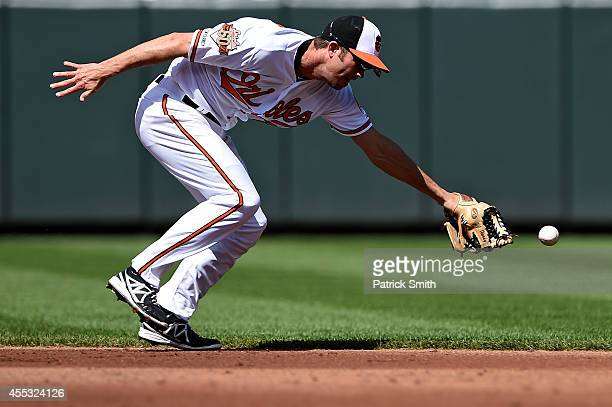 Shortstop JJ Hardy of the Baltimore Orioles cannot make a play on a hit by Jacoby Ellsbury of the New York Yankees in the third inning during game...