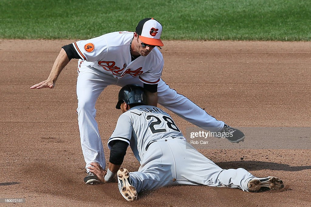 Shortstop <a gi-track='captionPersonalityLinkClicked' href=/galleries/search?phrase=J.J.+Hardy&family=editorial&specificpeople=216446 ng-click='$event.stopPropagation()'>J.J. Hardy</a> #2 of the Baltimore Orioles tags out Leury Garcia #28 of the Chicago White Sox trying to steal second base during the seventh inning at Oriole Park at Camden Yards on September 8, 2013 in Baltimore, Maryland.