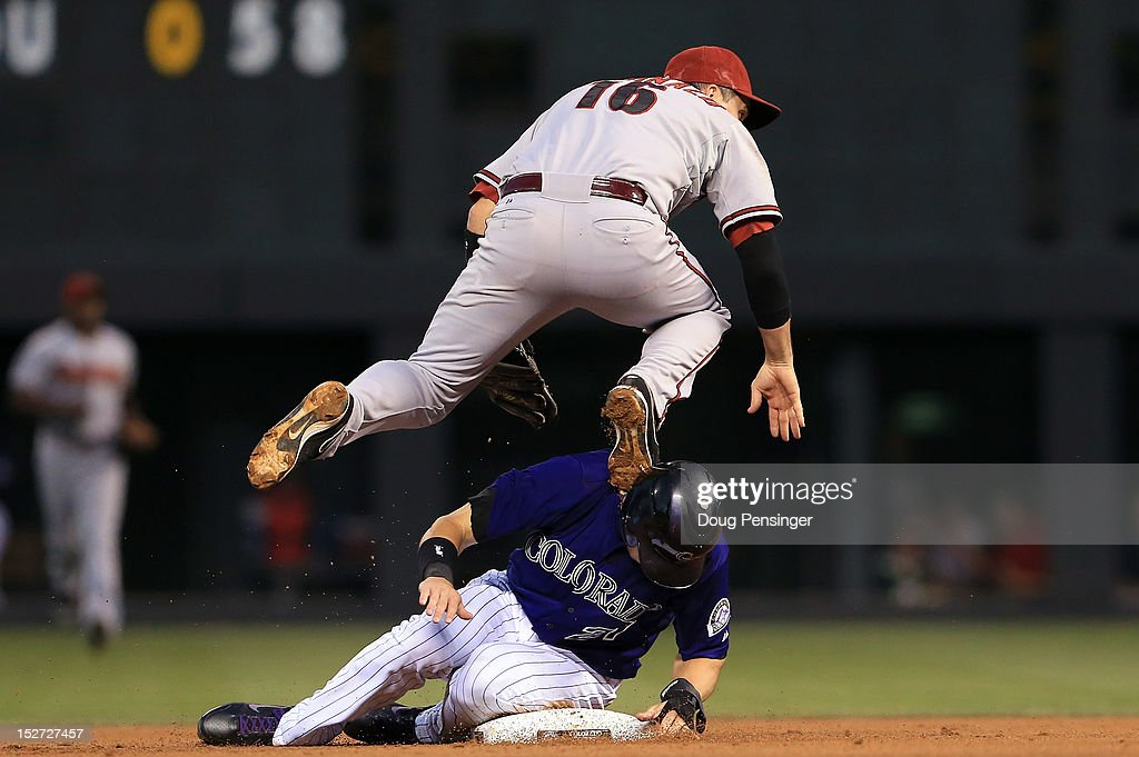 Shortstop <a gi-track='captionPersonalityLinkClicked' href=/galleries/search?phrase=John+McDonald+-+Baseball+Player&family=editorial&specificpeople=215395 ng-click='$event.stopPropagation()'>John McDonald</a> #16 of the Arizona Diamondbacks collides with <a gi-track='captionPersonalityLinkClicked' href=/galleries/search?phrase=Tyler+Colvin&family=editorial&specificpeople=4175115 ng-click='$event.stopPropagation()'>Tyler Colvin</a> #21 of the Colorado Rockies as he turns a double play to end the first inning at Coors Field on September 24, 2012 in Denver, Colorado.