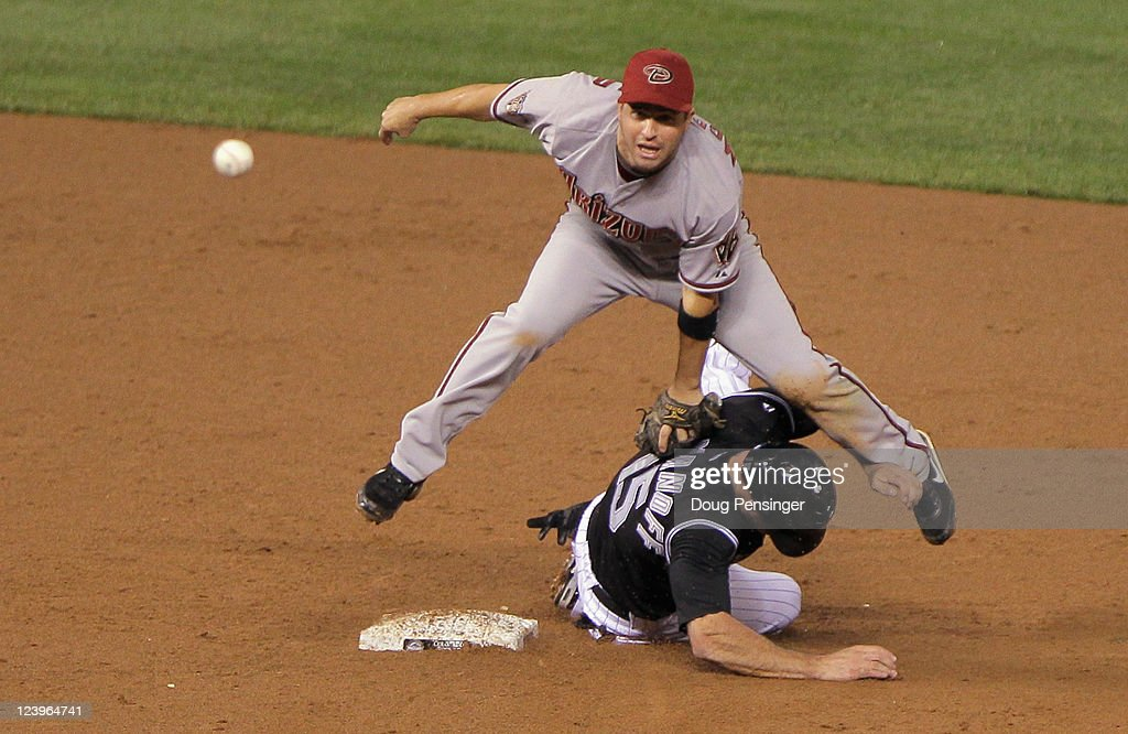 Shortstop <a gi-track='captionPersonalityLinkClicked' href=/galleries/search?phrase=John+McDonald+-+Baseball+Player&family=editorial&specificpeople=215395 ng-click='$event.stopPropagation()'>John McDonald</a> #16 of the Arizona Diamondbacks gets a force out on <a gi-track='captionPersonalityLinkClicked' href=/galleries/search?phrase=Kevin+Kouzmanoff&family=editorial&specificpeople=4027833 ng-click='$event.stopPropagation()'>Kevin Kouzmanoff</a> #15 of the Colorado Rockies but was unable to complete the double play at Coors Field on September 6, 2011 in Denver, Colorado. The play produced the second out of the eighth inning before the Rockies rallied for seven runs to defeat the Diamondbacks 8-3.