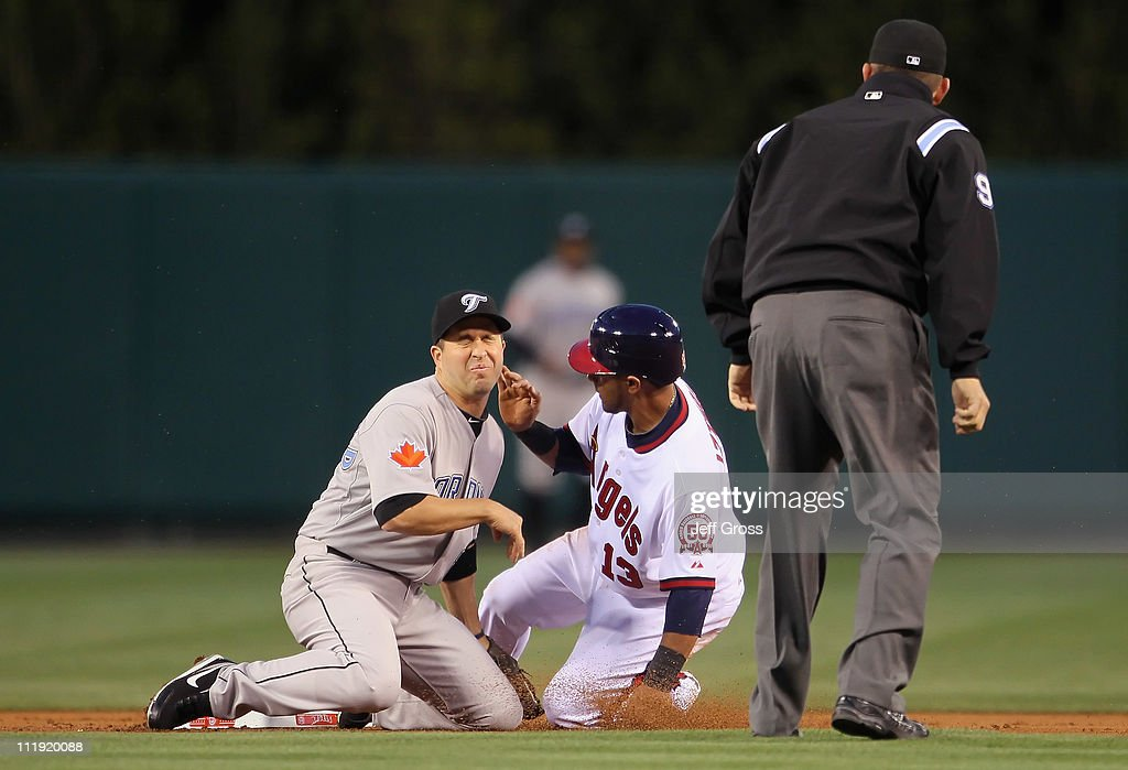 Shortstop <a gi-track='captionPersonalityLinkClicked' href=/galleries/search?phrase=John+McDonald+-+Baseball+Player&family=editorial&specificpeople=215395 ng-click='$event.stopPropagation()'>John McDonald</a> #6 of the Toronto Blue Jays grimaces as he catches <a gi-track='captionPersonalityLinkClicked' href=/galleries/search?phrase=Maicer+Izturis&family=editorial&specificpeople=239100 ng-click='$event.stopPropagation()'>Maicer Izturis</a> #13 of the Los Angeles Angels of Anaheim stealing second base in the first inning at Angel Stadium of Anaheim on April 8, 2011 in Anaheim, California. The Blue Jays defeated the Angels 3-2.
