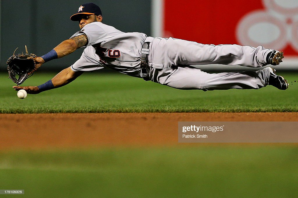 Shortstop Jonathan Villar #6 of the Houston Astros cannot grab a hit by Steve Pearce #28 of the Baltimore Orioles (not pictured) in the eighth inning at Oriole Park at Camden Yards on July 31, 2013 in Baltimore, Maryland. The Houston Astros won, 11-0.
