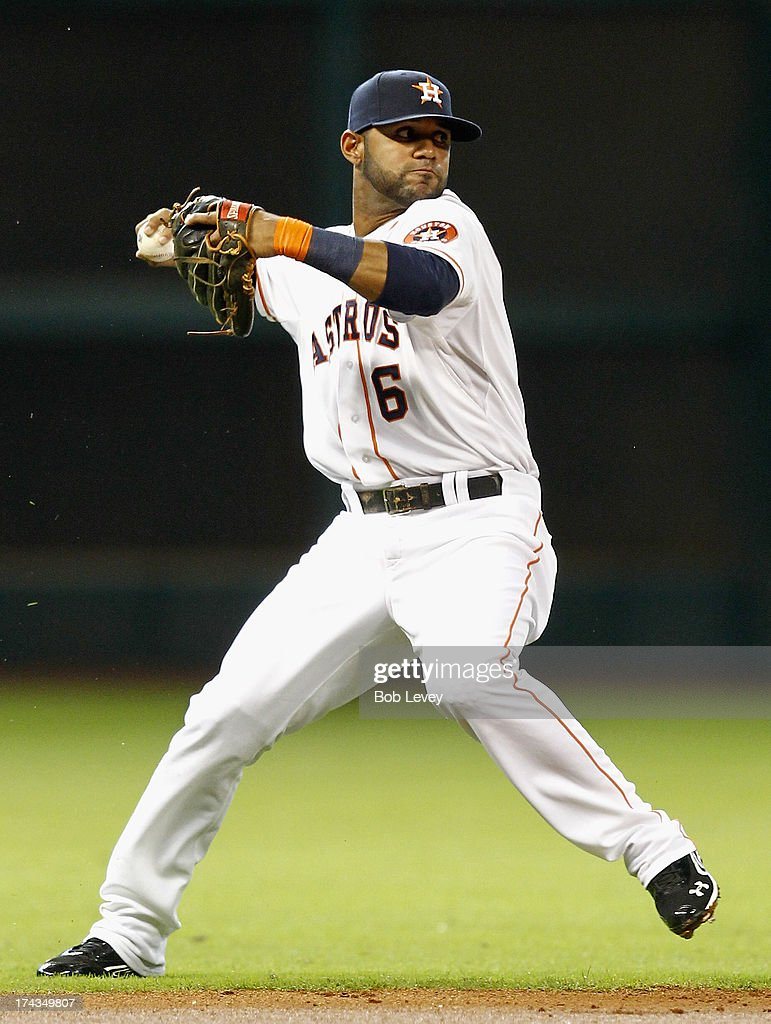Shortstop Jonathan Villar #6 of the Houston Astros throws to first base to retire Yoenis Cespedes of the Oakland Athletics in the second inning at Minute Maid Park on July 24, 2013 in Houston, Texas.