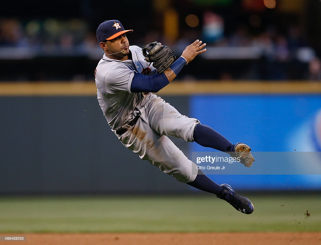 Shortstop Jonathan Villar of the Houston Astros throws to first on a single off the bat of James Jones of the Seattle Mariners in the fourth inning...