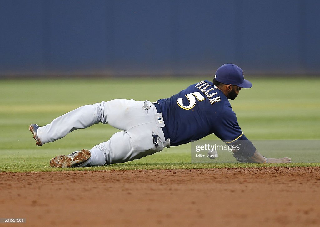 Shortstop Jonathan Villar #5 of the Milwaukee Brewers dives unsuccessfully for a ground ball in the second inning during the game against the Atlanta Braves at Turner Field on May 26, 2016 in Atlanta, Georgia.